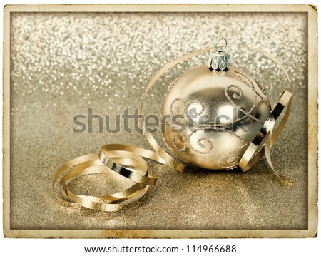 golden christmas ball with streamer over golden shiny background. vintage post card design - stock photo