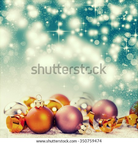 Golden Christmas balls and decorations on white background - stock photo