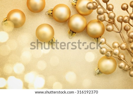 Golden Christmas balls on glitter background - stock photo