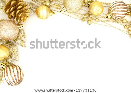 Golden Christmas border of baubles and shiny branches - stock photo