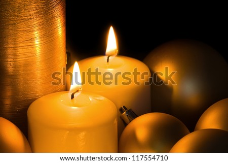 Golden Christmas Candles and spheres on the black