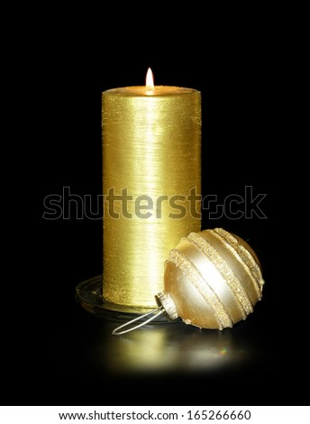 Golden Christmas Candles and spheres on the black - stock photo