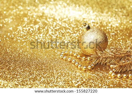Golden christmas decoration on glitter background - stock photo