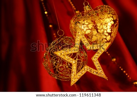 Golden christmas decoration on red fabric background - stock photo