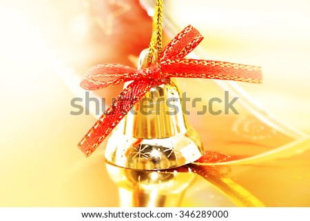 Golden Christmas decoration on shiny background. Holiday background or greeting card. Selective focus. - stock photo