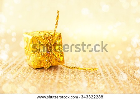 Golden Christmas decoration on shiny background with copy space for text. Holiday background or greeting card. Selective focus. - stock photo