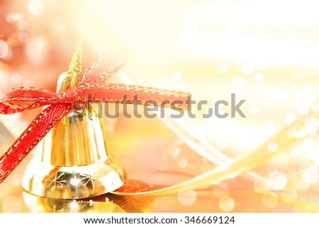 Golden Christmas decoration on shiny background with copy space for text. Holiday background or greeting card. Selective focus.