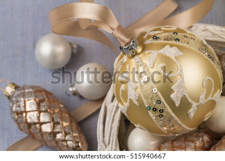 Golden Christmas decorations and silk ribbons.