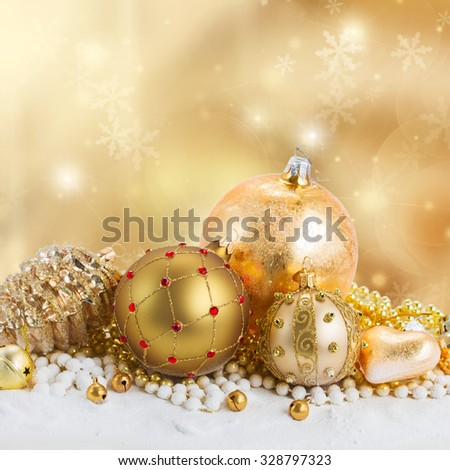 golden christmas decorations border on bokeh background with sparkles