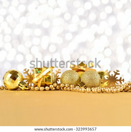 Golden Christmas decorations on a silvery background