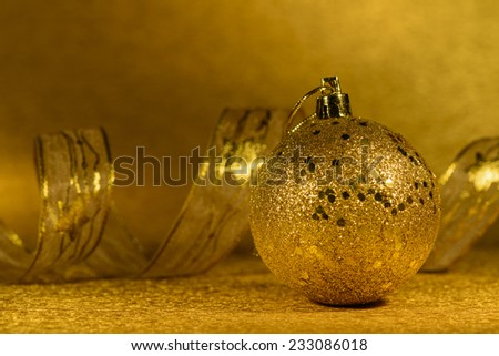 Golden Christmas decorations on golden organza background, with clipping path