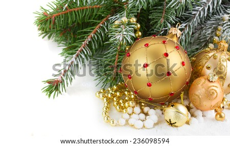 golden christmas decorations with evergreen tree  close up  on white background - stock photo
