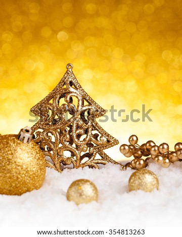 Golden christmas fir tree decoration on glitter background