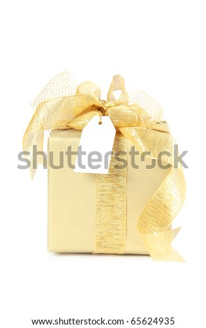 Golden christmas gift box with blank paper tag isolated on white background - stock photo