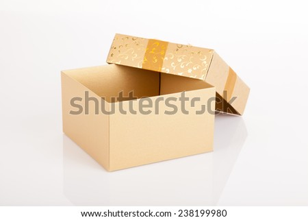 Golden christmas gift box with lid off on white background