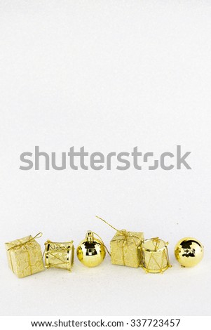 Golden Christmas Ornaments  with glittering white background.