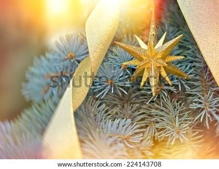 Golden Christmas star - Christmas decoration - stock photo