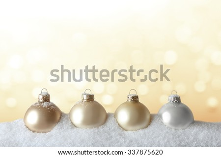 Golden christmas tree decoration, baubles and stars, on snow, background, copy or text space - stock photo