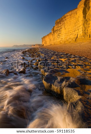 Golden cliffs & incoming tide , Burton Bradstock, Dorset, UK
