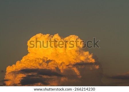 golden clouds in dramatic light at sunset/sunrise - stock photo