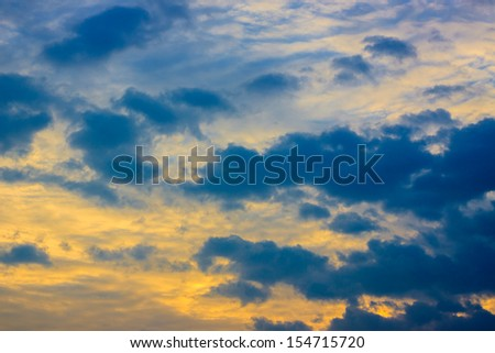 Golden clouds on the sunrise sky - stock photo