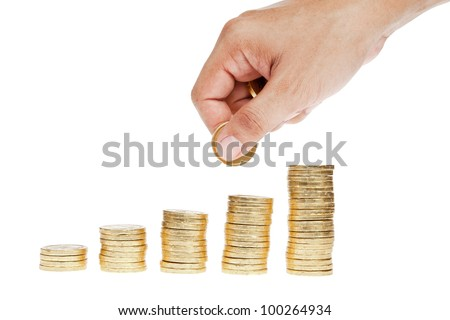Golden coin stacks isolated and hand holding coins as saving concept - stock photo