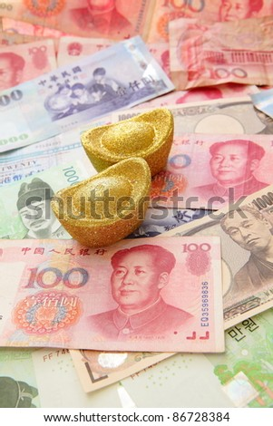 Golden coins and Background of asian currency (include Korean Won, Taiwan dollar, Chinese Money yuan , Hong Kong Dollar, japanese Yen) - stock photo