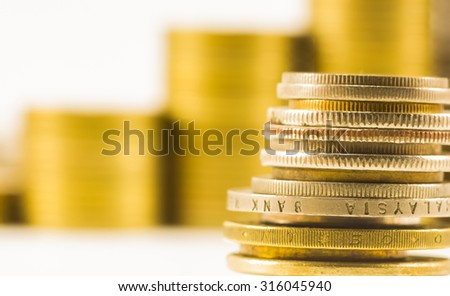 golden coins and coins stacked on each other in different positions - stock photo