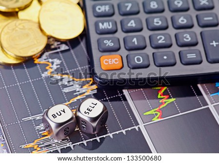 Golden coins and financial chart as  background. Selective focus - stock photo