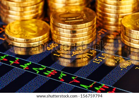 Golden coins and financial chart. Selective focus - stock photo