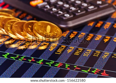 Golden coins, calculator and chart. Selective focus - stock photo