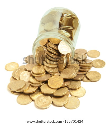 Golden coins in glass on white background - stock photo