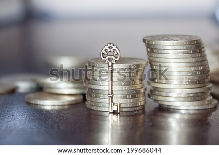 golden coins with golden key, key to money, business financial success concept