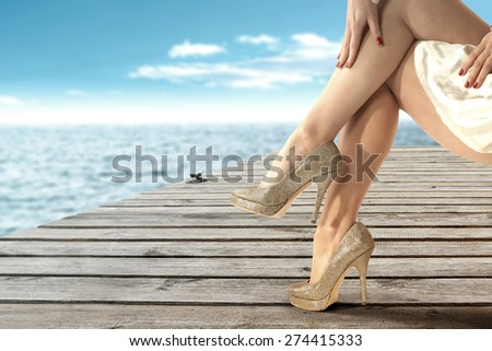 golden color of shoes and woman on pier