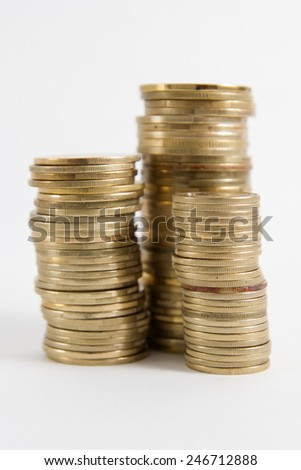 Golden columns of coins isolated on white background - stock photo