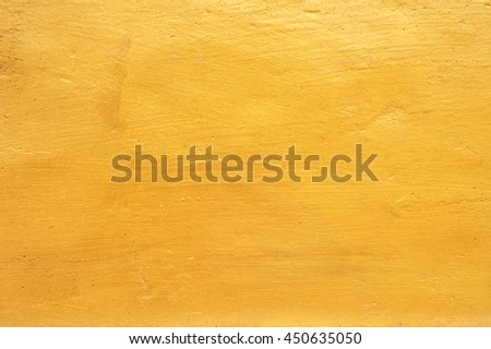 Golden concrete wall background - stock photo