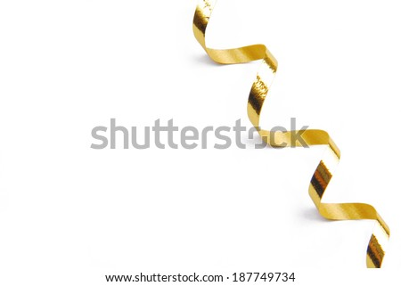 golden confetti serpentine ribbon isolated on white - stock photo