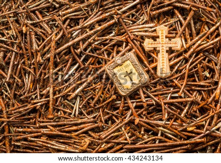 Golden cross and Bible on some used rusted old nails. - stock photo