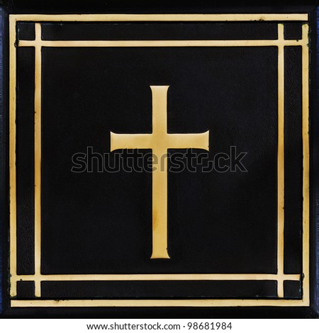 Golden cross, symbol of the Christian faith on the black background - stock photo