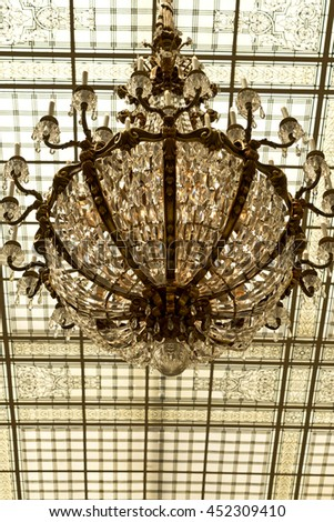 Golden Crystal Chandelier and Glass Ceiling  - stock photo