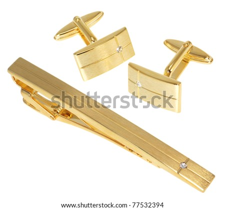 golden cuff link and tie pin isolated on white - stock photo