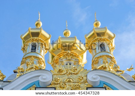 Golden cupolas of Catherine Palace church on the sky background, suburb of St.Petersburg, Russia. - stock photo