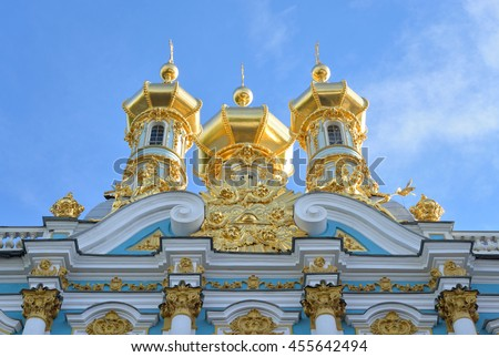 Golden cupolas of Catherine Palace church on the sky background, suburb of St. Petersburg, Russia. - stock photo