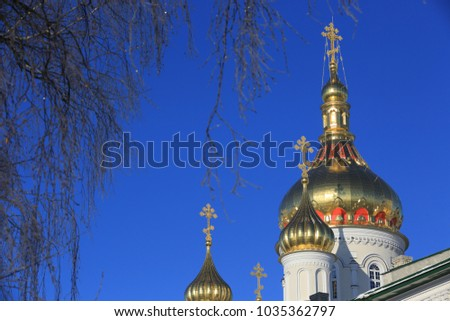 Golden Cupolla Holy Dormition Pochayiv Lavra in morning light, Ukraine