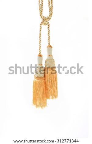 golden curtain tassel on white background - stock photo