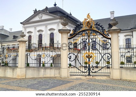 Golden decorations on cast iron gate and Presidential Palace (Grassalkovich Palace), Bratislava, Slovakia - stock photo