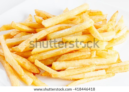 Golden delicious fries close up, may be used as background - stock photo