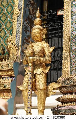 Golden Demon Guardian Wat Phra Kaew Grand Palace Bangkok - stock photo