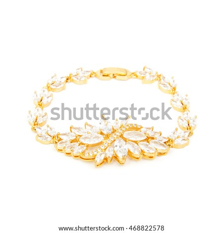 Golden diamond bracelet isolated on white background