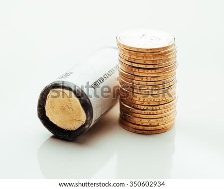 golden dollar coins, US mint roll - stock photo